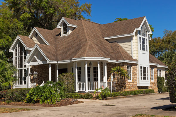 Residential home with brown shingles